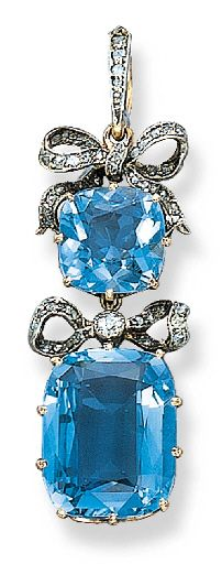 AN ANTIQUE AQUAMARINE AND DIAMOND PENDANT  Set with two cushion-shaped aquamarines with diamond-set ribbon bow spacers, with Russian assay marks Marked with initials AT, St. Petersburg, 1896-1908