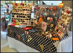 Craft show booth display.  Like the hanging pennants.