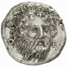 Extremely Rare & Fine Greek Coin Showing Dionysos This stater is worth about $211,000 and is the finest example of this type known. It's from the ancient city of Thebes in Boeotia from around 405-395 BC. On the obverse is a Boeotian shield with the reverse side displaying an image of Dionysos wearing an ivy wreath with the letters Θ and Ε.