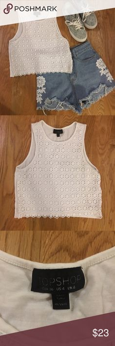 Top shop lace crop top Super cute and elegant crop top. Matches everything because it is white. The lace is super pretty and has no pulls anywhere. Perfect to dress us or wear casually Topshop Tops Crop Tops