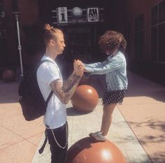 Machine Gun Kelly enjoying some downtime with a tiny fan.