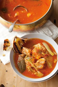 Bouillabaisse is a traditional dish of Marseille, a fish soup that is eaten with croutons of bread slathered often garlicky, rust, served whole fish and potatoes