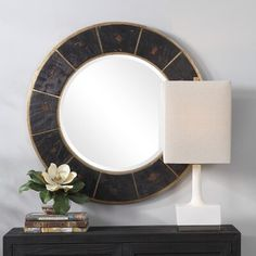 Breakwater Bay This round mirror is set on a gold leaf base layered with rustic, dark wooden blocks that have alternating diamond and butterfly inlay accents. The mirror has a bevel. Round Wall Mirror, Round Mirrors, Framed Mirrors, Mirror Glass, Cottage Wall Mirrors, Mirror Hanging Brackets, Modern Full Length Mirrors, Traditional Wall Mirrors, Painted Fox Home