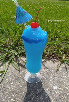 BLUE BOOZIE RASPBERRY SNOWBALL  Add in blender 1 1/2 oz. (45 ml) Bleu storm vodka 1 oz. (30 ml) Tropical island pucker 1 oz. (30 ml) Blue raspberry juice 2 blue raspberry snow ball syrup Ice blend pour in glass garnish with a umbrella in a cherry