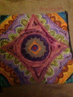 Rug hooked design inspired by Bea Brock.