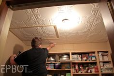 EPBOT: DIY Faux Tin Tile Ceiling These tiles are styrofoam, can be applied right over popcorn ceilings and can be painted. Tin Tiles, Tin Ceiling Tiles, Ceiling Panels, Bedroom Light Fixtures, Dream Home Design, Small Bedrooms, Budget, Extra Bedroom, Diy Bedroom