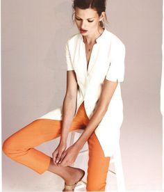 Orange pants with white long jacket