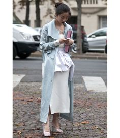 In an all white ensemble, it's amazing when the item that stands out the most is a pale blue trench.   - MarieClaire.com