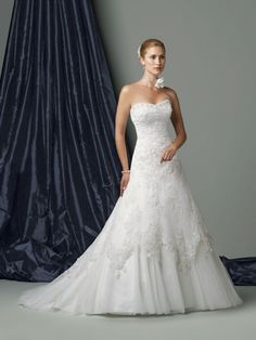embroidered softly curved neckline wedding dress