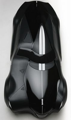 Saab 9 Griffin Concept Car. LOVE the asymmetrical design - looks like someone at SAAB has familiarized themselves with the work of Syd Mead (and it's about time!!)