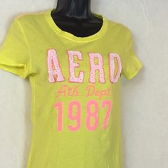 Aeropostale med short sleeve yellow tee Super cute - EUC time for summer. Yellow tee with orange and pink writing. 100% cotton measures 14 pit to pit 5 sleeve and 24 top to bottom. I take offers and bundles but no trades  Aeropostale Tops Tees - Short Sleeve