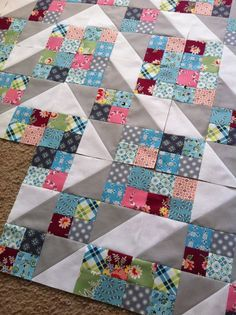Eye candy - looks like a great way to use scraps for the 16-patch! Love the gray and white HSTs.