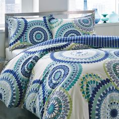 80,This Radius reversible comforter set from City Scene keeps your bedroom stylish and fashionable with its trendy print. The bright color scheme will fit in with many styles of decors, and the standard shams complete the look.