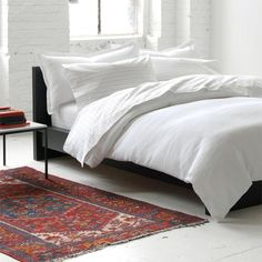 oriental rug and plain white duvet. NO extra pillows. 2 King pillows. 4 standard. nothing else.