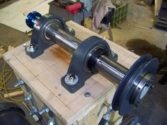 Wood Lathe Headstock by Mark Norman -- Homemade wood lathe headstock constructed from round bar stock, pillow bearings, and a pulley. http://www.homemadetools.net/homemade-wood-lathe-headstock