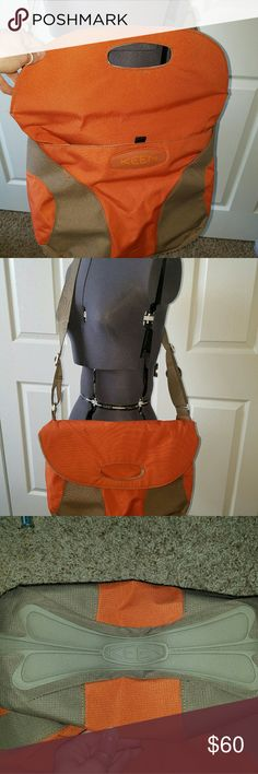 """KEEN Hybrid Transport Crossbody Should Bag Orange Pre-owned large KEEN Hybrid Transport Expandable Shoulder Bag  Style: Shoulder Bag, tote, messenger or cross body. Built in carry handles for bag expansion that has magnetic snap closure. Shoulder strap is Adjustable  and 2"""" wide. Made with recycled polyester and aluminum  Color: Orange and light brown  Condition:  In almost like new condition. Only one little spot on bottom of bag. See photos  MEASURES APPROX:  16"""" WIDE ACROSS TOP ... 21""""…"""
