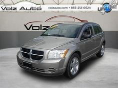 2009 Dodge Caliber. Car #5. Current car, not much longer!:) it is white :(( worst car I've owned, powerless windows, locks, seats, everything is do it yourself. Just installed cruise control. I've put more money in it the last 8 months than it's worth.