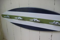 Awesome for boys room... Surf board coat rack with boat cleats