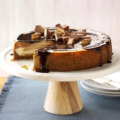 Peanut Butter Cup Cheesecake Recipe -I said I'd bring dessert to a holiday party and tried this recipe. I'm sure you'll agree it tastes as luscious as it looks! —Dawn Lowenstein, Hatboro, Pennsylvania