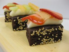Dessert Sushi- sliced brownies, cream cheese icing, thinly sliced fruits and berries-- SO FUN!