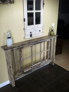 What and amazing handmade piece, with an antique window in the middle! Etsy.com