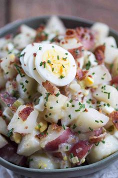Grandma's German Potato Salad features tender red potatoes, onions, and bacon in a sweet and tangy vinegar dressing. Grandma added hard boiled eggs so I did, too! It's a no-mayo potato salad that's perfect for picnics and outdoor get togethers. #potatosalad #germanpotatosalad #grandmasrecipe