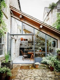 eighteenth-century weavers' cottage lovingly restored The courtyard entrance and kitchen, with its metal-framed windows, have an unexpected French feel.The courtyard entrance and kitchen, with its metal-framed windows, have an unexpected French feel.