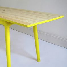 Ooh.  Pale unfinished wood with bright paint.  A cheap way to freshen up an Ikea table or similar.