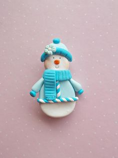 Christmas brooch created from polymer clay without molds or forms, with a lovely snowman with blue beanie. A perfect gift for winter holidays. The lenght of the brooch is 5 cm. It is not heavy. Suitable also for children. ❀ Because i make everything by hand, the item you receive may differ