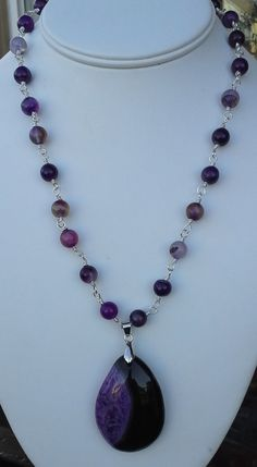 It is a delightful handmade agate necklace, using argentium wire for the chain round purple agate beads and a large purple and black agate teardrop for the pendant. The necklace measures: 18.5 The pendant: 31mm The agate small beads are:4mm The total weight of the necklace is: 50g We believe this necklace can be worn with many colors of clothes and be very elegant! Please email us for any question you may have Thank you for viewing our items and for your interest in shamirgems.  Ephraim…