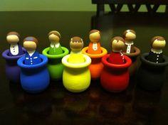 Dolls in wooden pots