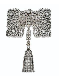 DIAMOND BOW BROOCH-COMB COMBINATION, CARTIER, PARIS, LATE 19TH CENTURY - Sotheby's