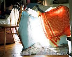 using sheets and blankets to make forts in the house