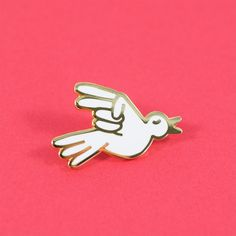 """Peace, man. The dove being the universal symbol of peace adds and extra chill vibe to this pin designed by Luke Day. The contrasting gold metal and white enamel are sure to make you shine. • 1.25"""" Har"""