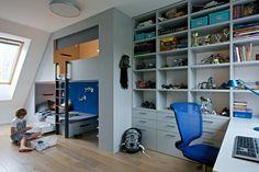 Interior designer Barbora Léblová, designed the interior of a family home, ncluding this boy's bedroom with a loft bed, and plenty of storage.