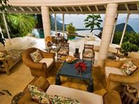 VILLA TAINO  Exotic House  This truly exotic home perched high on the western hills of Tortola was named after the first Indian people of Tortola. Villa Taino is luxury comfort in Caribbean and Polynesian style, mixed with lush gardens around a unique pool. Several terraces offer spectacular panoramic views.