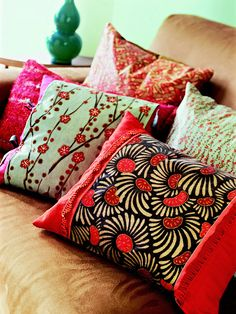 Have a copy center put an eye-catching scrapbook print onto transfer paper. Then transfer the design to throw pillows.