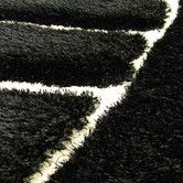 Found it at AllModern - Shaggy Black Abstract Wave Area Rug