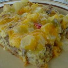 """Breakfast Pizza I Recipe:  LOVE this recipe!  Great for company.  Freezes well.  And you can use the rectangular """"seamless crescent dough sheet"""" or don't separate the triangles to bake on a cookie sheet instead of having to work to make the crescent dough fit a pizza pan."""