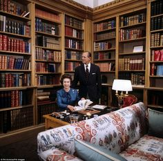 A photograph taken inside what is believed to be the library in Balmoral reveals how the Queen has decorated the space very traditionally - although she did purchase a Sky TV box.