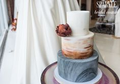 This cake looks stunning on top of @poprentals Marsala hued table! Our gorgeous alabaster SPARKLE gown is complimented by all of the chosen decor.  http://www.gigimallattevents.com/ @gigimallatt #gigimallattevents http://www.leilanipaular.com/ @lalalena #leilanipaularphotography http://www.popeventrentalsanddesigns.com/  #poprentalsanddesign http://www.paperheartpatisserie.com/ @paperheartp #paperheartpatisserie