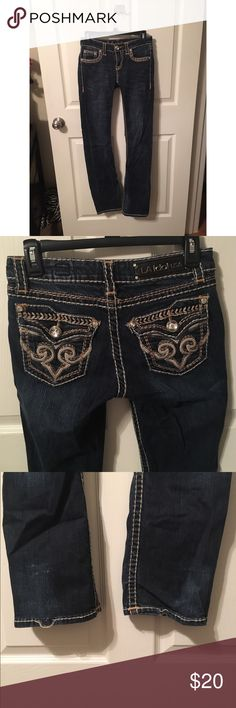 LA Idol Blue Jeans with rhinestone buttons Dark wash LA Idol USA blue jeans with large rhinestone buttons and clasp. Zip in the front. Small un threading in the bottom seam but nothing a needle and thread can't fix! Great comfortable fit! Pants Boot Cut & Flare