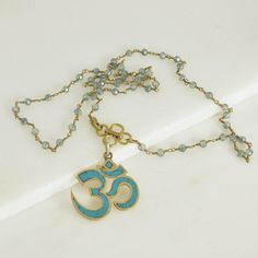 A personal favorite from my Etsy shop https://www.etsy.com/listing/516725318/om-namaste-inlaid-turquoise-pendant-om