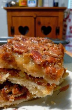 "Pecan Pie Bars - Favorite go- to dessert for parties and potlucks because it's baked in a 13x9 pan instead of a 9"" pie pan. It's also the first dessert to disappear! Sooo goood!.."