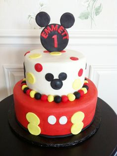 Mickey Mouse Cake - Customer found this design online - so I have no idea who to give credit to - buttercream iced cake with fondant accents.  Mickey topper made out of modeling chocolate.  thanks for looking!  Lisa