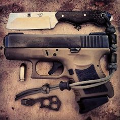 G27 FDE with Atwood and sweet fixed blade. I like this one, the sandstorm looks nice.