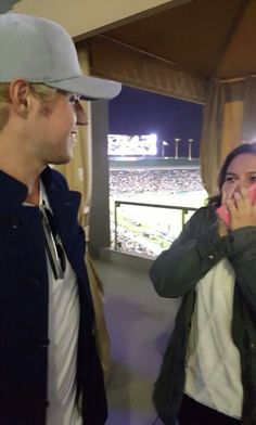 Niall at the LA Galaxy game with a fan  06/03/16