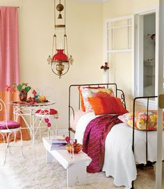 Color Theory...You can introduce lots of strong colors to a room if you keep the values of each color the same. Here, touches of deep aqua blue function to balance out the saturated reds, pinks, and oranges. Saris are a wonderful, and wonderfully easy way to bring out your room's palette.