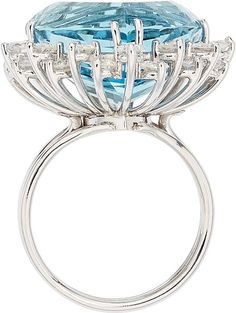 Aquamarine, Diamond, White Gold Ring  The ring features a shield-cut aquamarine measuring 17.55 x 14.90 x 10.15 mm and weighing approximately 15.25 carats, enhanced by full-cut diamonds weighing a total of approximately 1.55 carats, set in 14k white gold. Gross weight 8.80 grams
