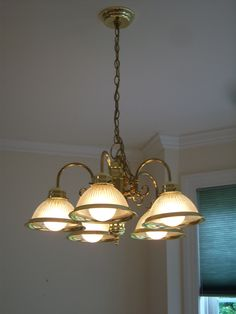 This Out Dated Brass lighting fixture came with the house. I'm going to DIY it with paint to save money!